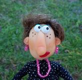 Puppet lady. Cold porcelain clay sculpted puppet Royalty Free Stock Image