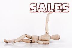 Puppet laying at ground, with its right arm up royalty free stock image