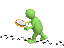 Puppet with a magnifier, going on traces. Of an animal. Objects over white Royalty Free Stock Images