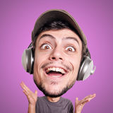 Puppet man listening to music with big head Royalty Free Stock Images