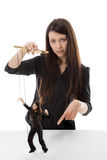 Puppet master. Business woman holding a puppet of herself pulling strings Royalty Free Stock Photography