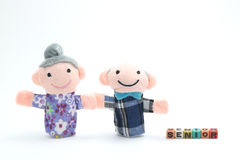 Puppet of the old couple with letters of senior. Royalty Free Stock Photo