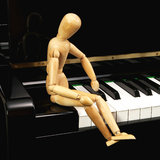 Puppet on piano Royalty Free Stock Photo