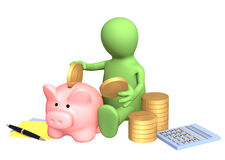 Puppet, piggy bank and calculator Stock Photography