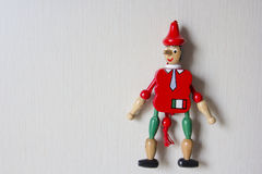 Puppet Pinocchio. On the wall Stock Photography