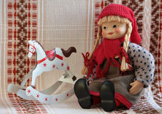 Puppet with rocking horse Stock Photo