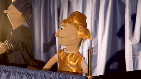 Puppet Roman soldier in action. In the background there is the other puppet character stock footage