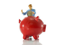 Puppet is saving money in moneypig Royalty Free Stock Image