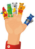 Puppet-show. Children wearing a hand with fingers on puppets - Tales characters Royalty Free Stock Photos