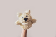 Puppet show dog on a gray background. Space for text or replicas.  Stock Photography
