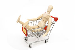 Puppet sit in shopping cart Stock Photography