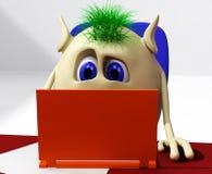 Puppet sitting behind orange laptop on chair Royalty Free Stock Image