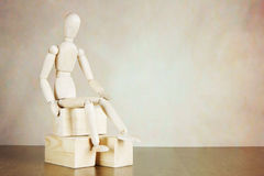 Puppet sitting on the wooden blocks Royalty Free Stock Images