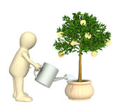 Puppet, watering monetary tree Royalty Free Stock Image