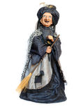 Puppet witch. Doll witch with a broomstick isolated on white Stock Photos
