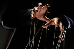 Puppeteer. Conceptual series: hands of puppeteer with rope Royalty Free Stock Images
