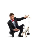 Puppeteer and business woman Stock Image