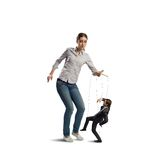 Puppeteer controls a businessman. Holding his strings, the concept of control of business royalty free stock image