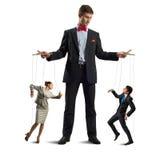 Puppeteer i kukły biznes Zdjęcie Stock