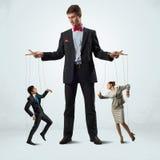 Puppeteer i kukły biznes Fotografia Stock