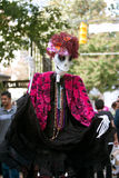 Puppeteer Performs With Halloween Skeleton In Park Stock Photography