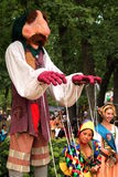Puppetmaster at the renaissance fair Stock Images