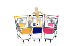 Puppetry models pushing many shopping carts Royalty Free Stock Image