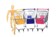 Puppetry models pushing many shopping carts Stock Photo