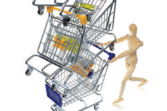 Puppetry models pushing many shopping carts Royalty Free Stock Images