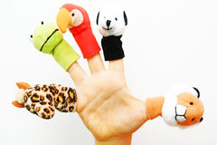 Puppets. Five funny finger puppets on the white background royalty free stock photo