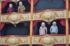 Puppets on a balcony. Funny puppets on a decorated balcony at the festival of Ghent Royalty Free Stock Image