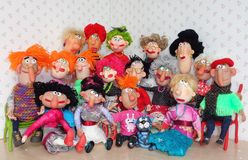 Puppets big family. Cold porcelain clay sculpted puppets Royalty Free Stock Photo