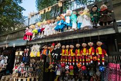 Trinkets in Prague, Czech Republic. Puppets in colorful costumes and Trinkets for sale in Prague royalty free stock photography