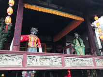 Puppets on facade of opera stage in XingPing Stock Images