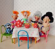 Puppets family. Cold porcelain clay sculpted puppets royalty free stock images