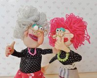 Puppets friends talk together. Cold porcelain clay sculpted puppets Stock Images