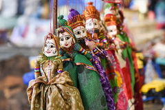 Puppets India Rajasthan. Handicraft of puppets attached to string in Rajasthan India. Women face with traditional Indian makeup wearing saree Royalty Free Stock Photo