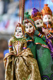 Puppets India Rajasthan. Handicraft of puppets attached to string in Rajasthan India. Women face with traditional Indian makeup wearing saree Stock Image