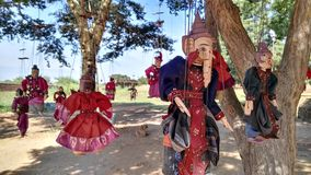 Puppets hanging from a tree. Old puppets hanging from a tree in a temple, Old Bagan Stock Photography