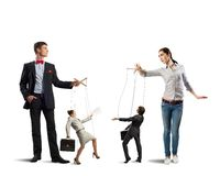 Puppets and puppeteers business Stock Photography
