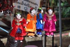 Puppets for sale at Luang Prabang Laos market Stock Photo