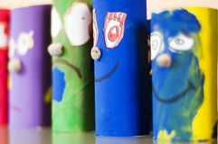 Puppets standing. Colored cylinder shaped puppets standing Stock Photos
