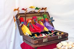 Puppets in a suitcase. At an artisan`s stall in a Day of the Dead market, Cotacachi, Ecuador royalty free stock image