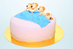Puppies in bed theme - fondant cake Royalty Free Stock Image