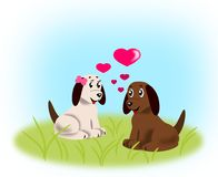 Puppies in Love. Two little puppies that are sitting and looking at each Royalty Free Stock Photos