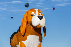 Puppy air balloon rising Royalty Free Stock Images