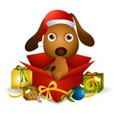 Puppy Christmas Present. An illustration featuring a cute puppy sitting in a Christmas present box Royalty Free Stock Photo