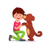 Puppy dog licking kids boy face Royalty Free Stock Photos