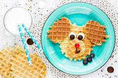 Puppy dog waffles for baby breakfast. Animal-shaped adorable art. Food for kid. Creative idea for child fun dessert or breakfast Royalty Free Stock Images