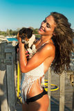 Puppy and girl at seaside Stock Images